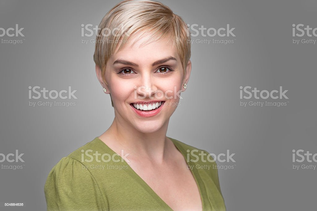 Young attractive fashionable headshot short pixie hair perfect smile teeth stock photo