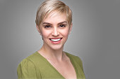 Young attractive fashionable headshot short pixie hair perfect smile teeth