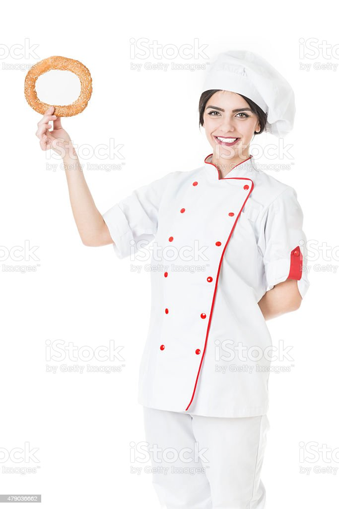 Young Attractive Female Baker, Chef Holding Fresh Pretzel stock photo