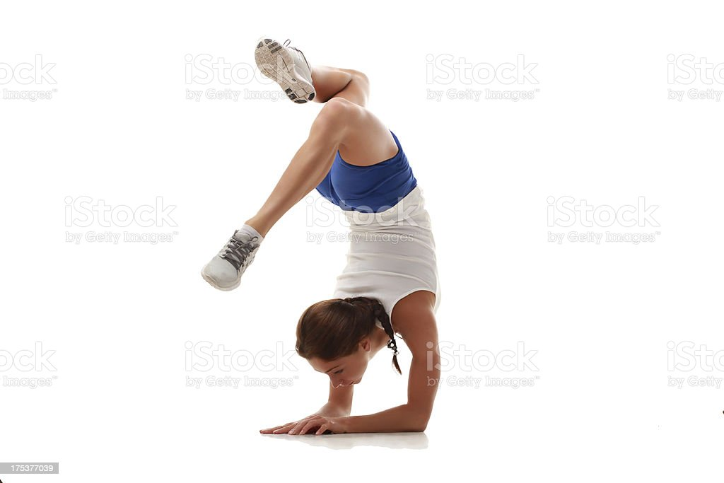 Young attractive female fitness model in handstand royalty-free stock photo
