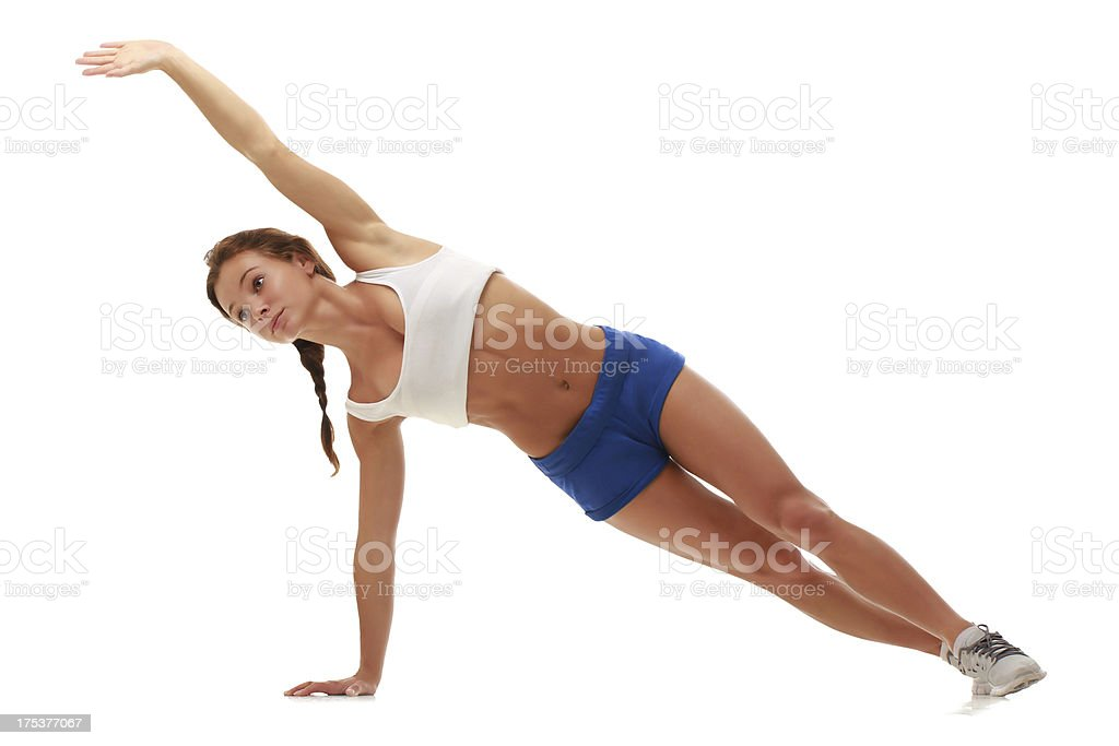 Young attractive female fitness model standing on one hand royalty-free stock photo