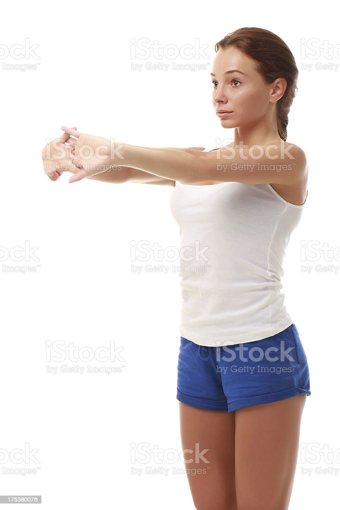 Young attractive female fitness model stretching royalty-free stock photo