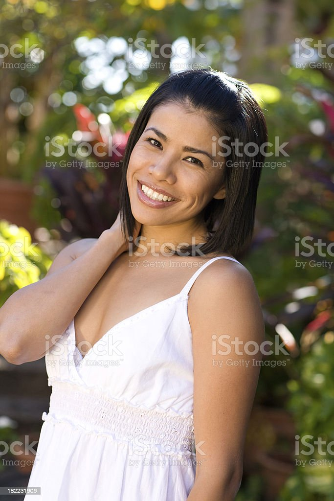 Young attractive female model standing in garden royalty-free stock photo