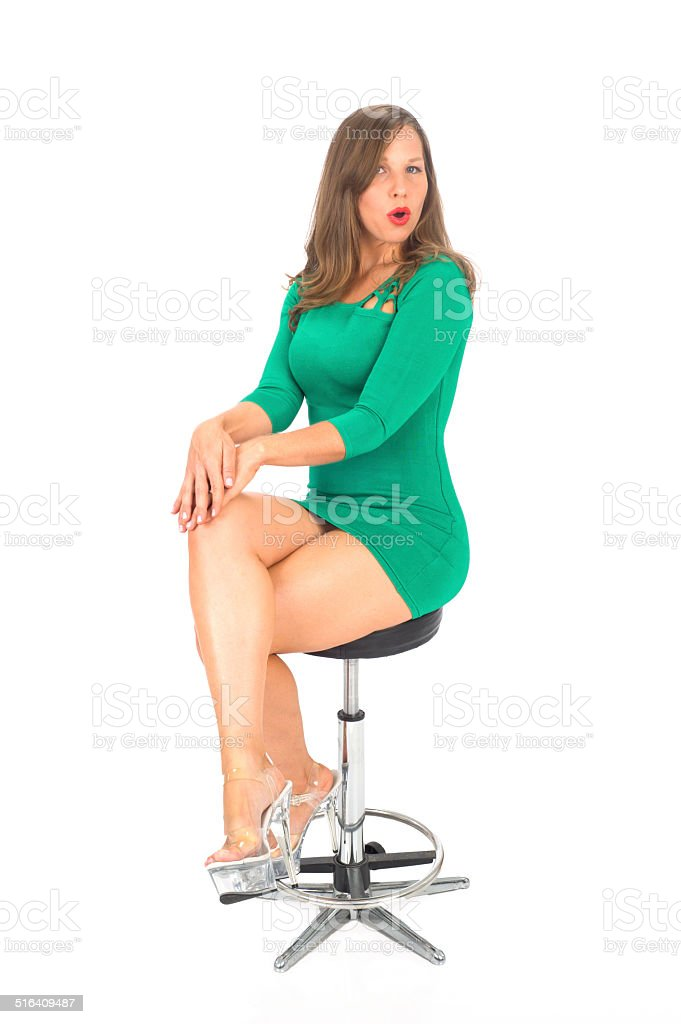 Young Attractive Female Wearing a Short Green Dress stock photo