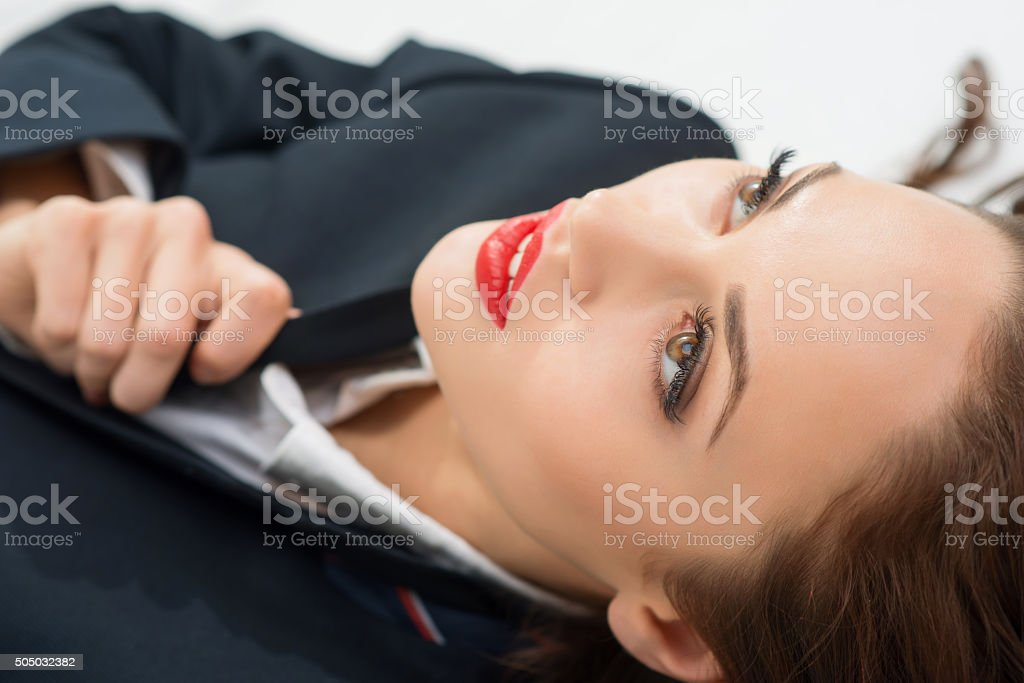 Young attractive girl in male role is staring up stock photo