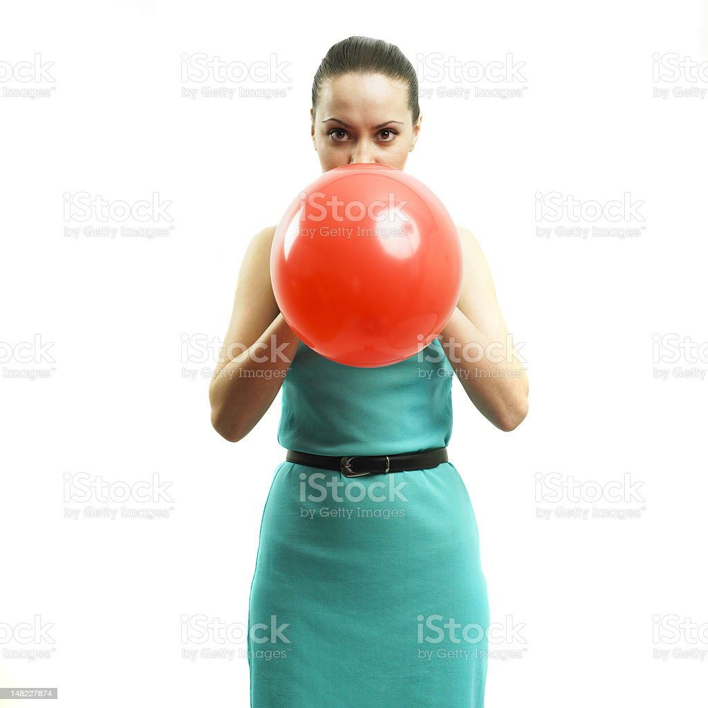 Young attractive girl inflating a balloon royalty-free stock photo