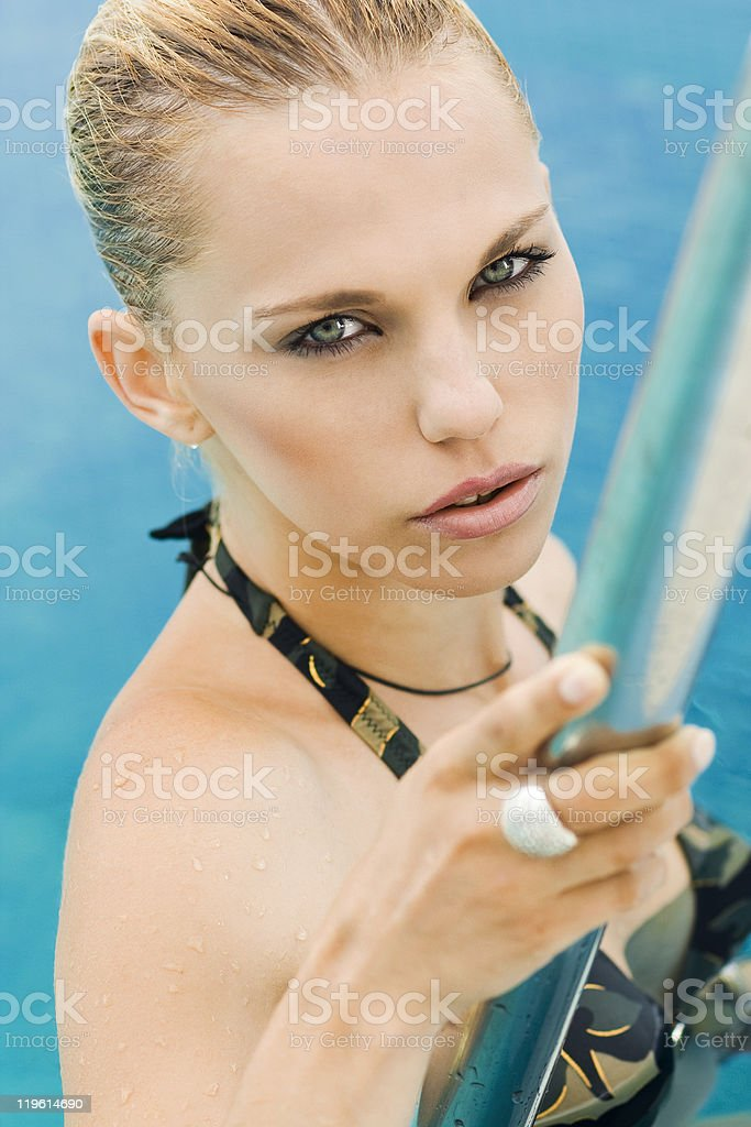 young attractive girl leaves pool royalty-free stock photo