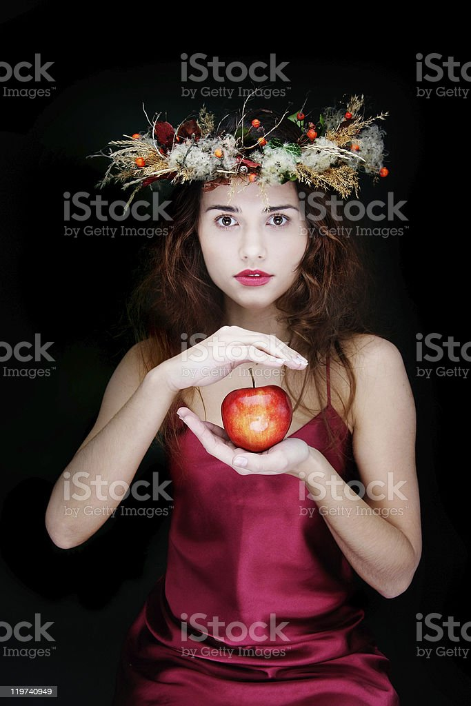 young attractive girl with apple over black royalty-free stock photo