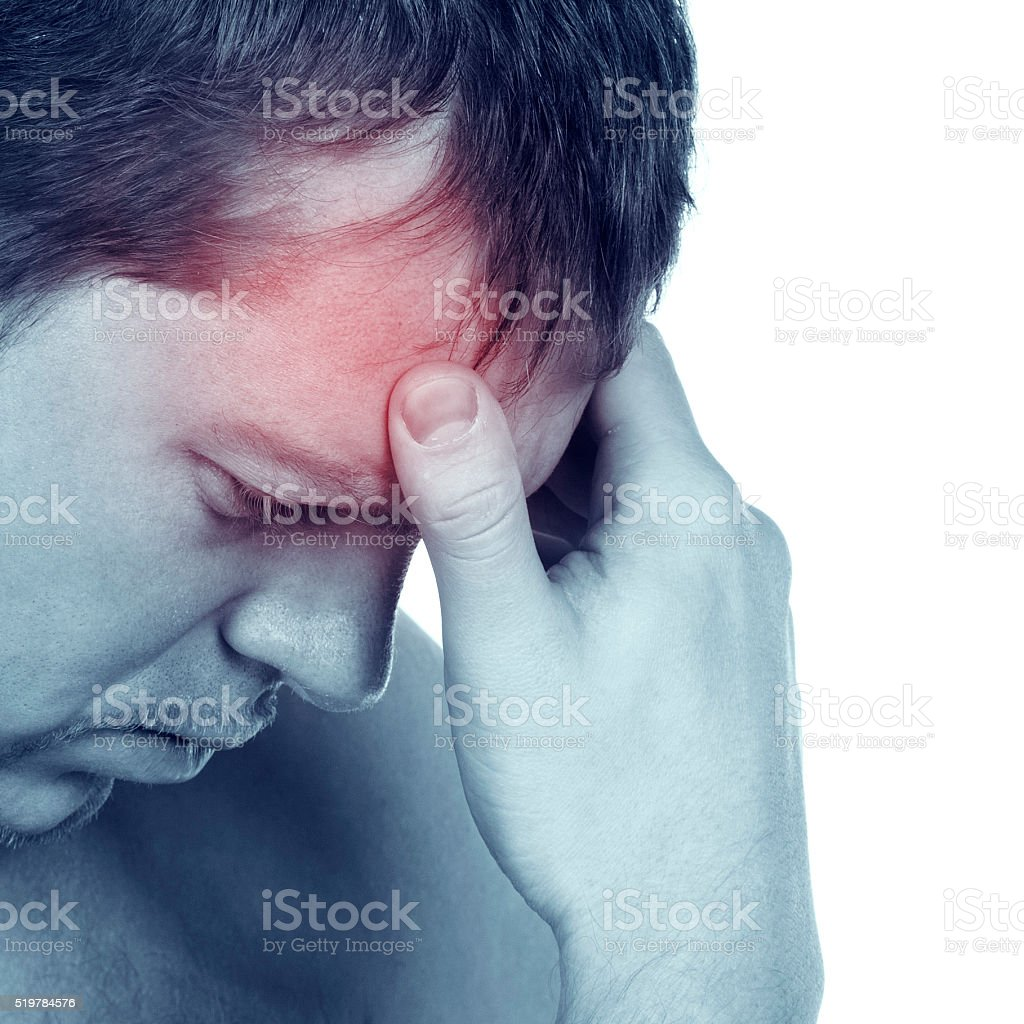 Young attractive guy tests a terrible migraine stock photo