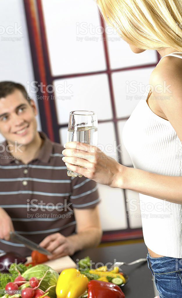Young attractive happy smiling couple at kitchen royalty-free stock photo