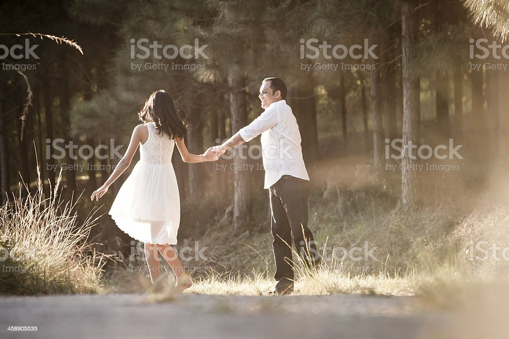 Young attractive indian couple outdoors wearing white stock photo