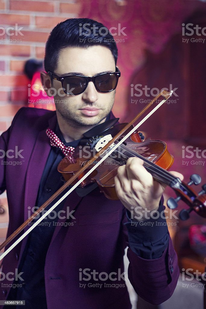 Young Attractive Male Playing his Violin with Expression stock photo
