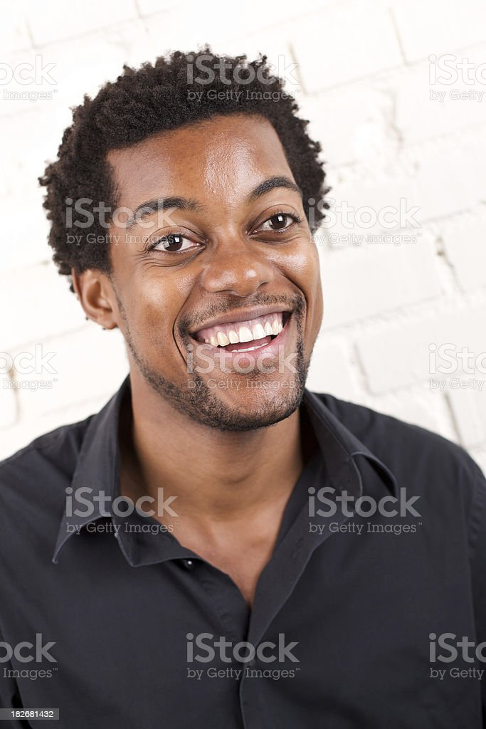 Young attractive male smiling at camera royalty-free stock photo