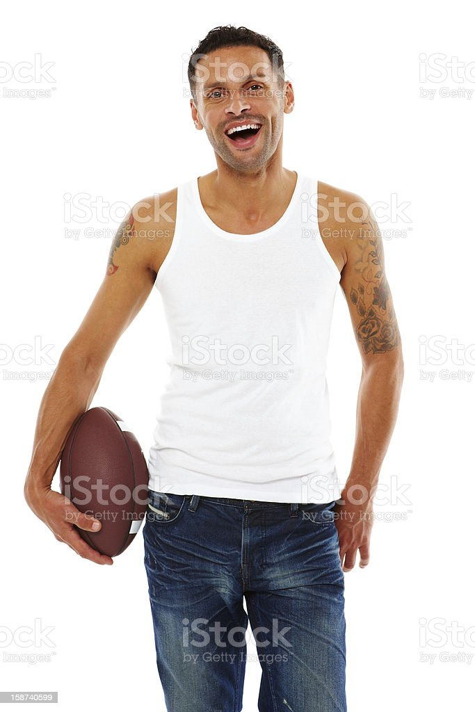Young attractive male with american football. royalty-free stock photo