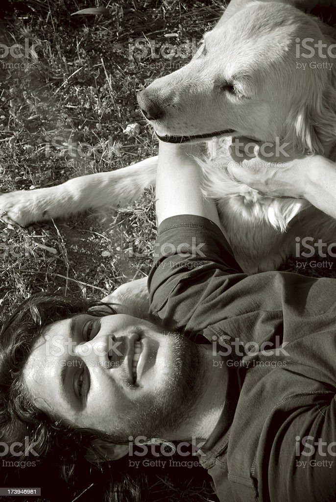Young attractive male with dog royalty-free stock photo