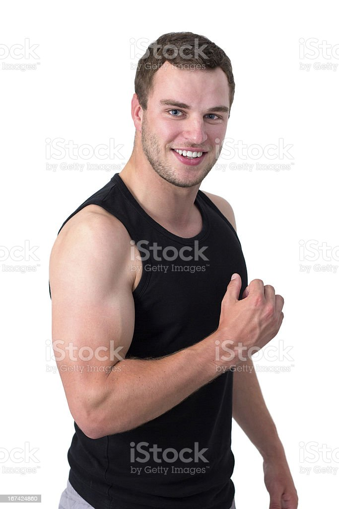 Young attractive man flexing his biceps royalty-free stock photo