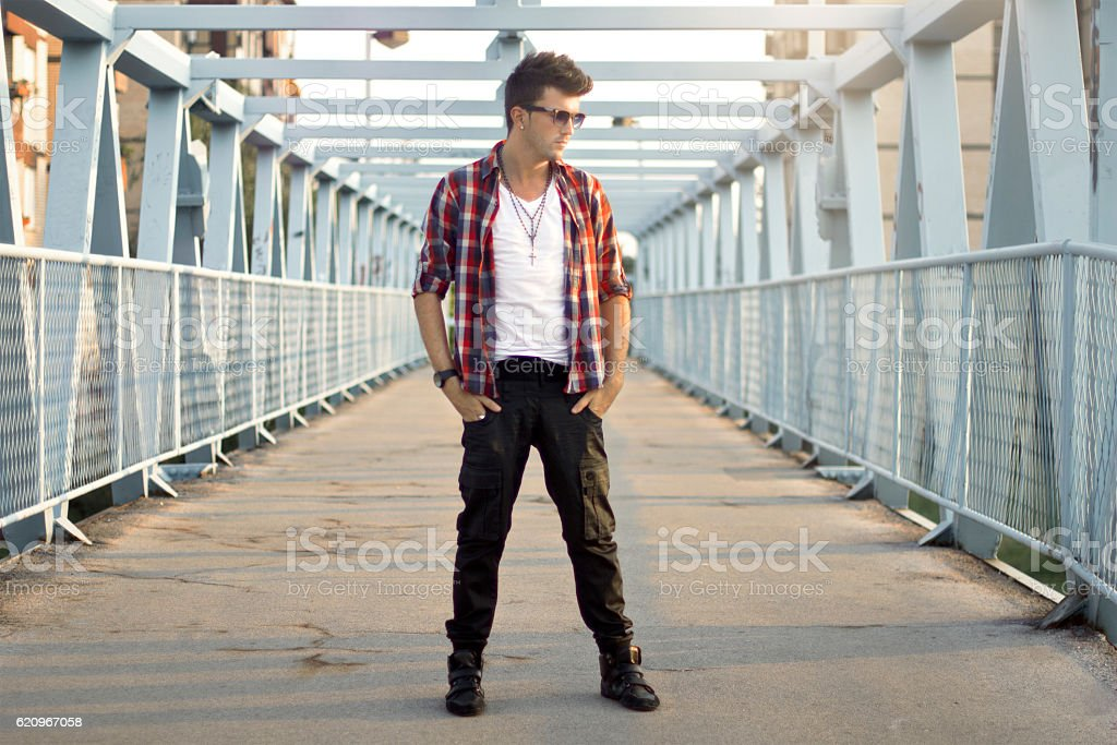 Young attractive man in urban background stock photo