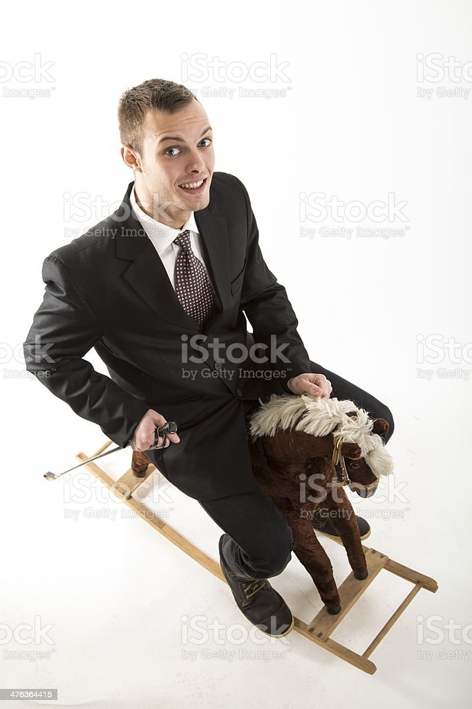 young attractive man on rocking horse stock photo