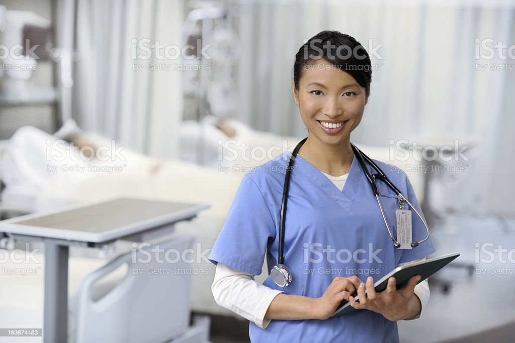 Young attractive nurse working on a tablet royalty-free stock photo