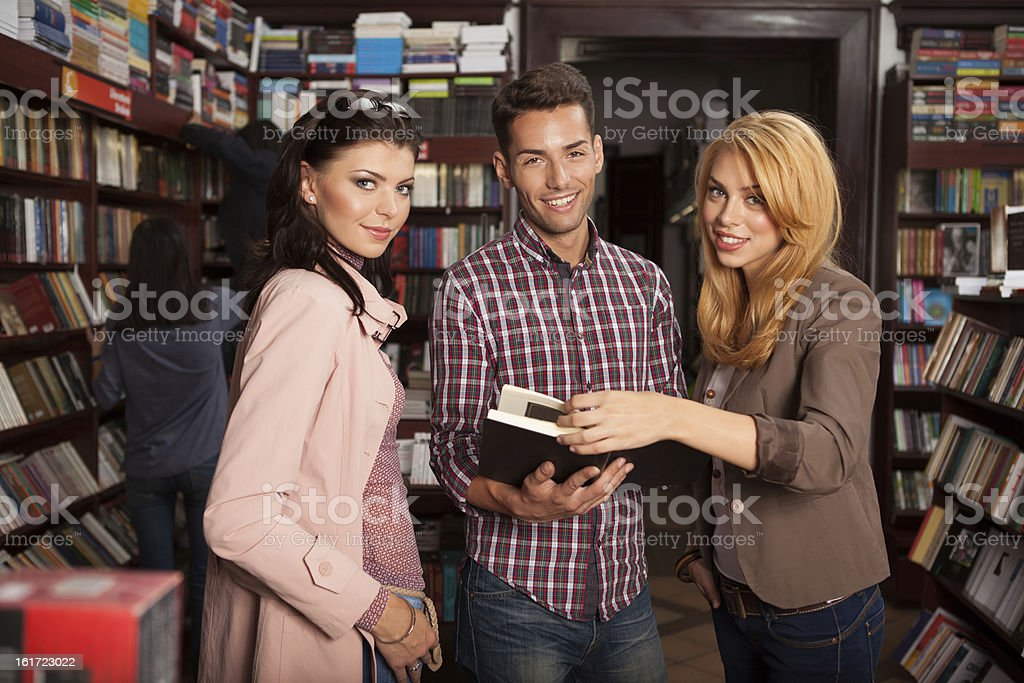 young attractive people in bookstore royalty-free stock photo