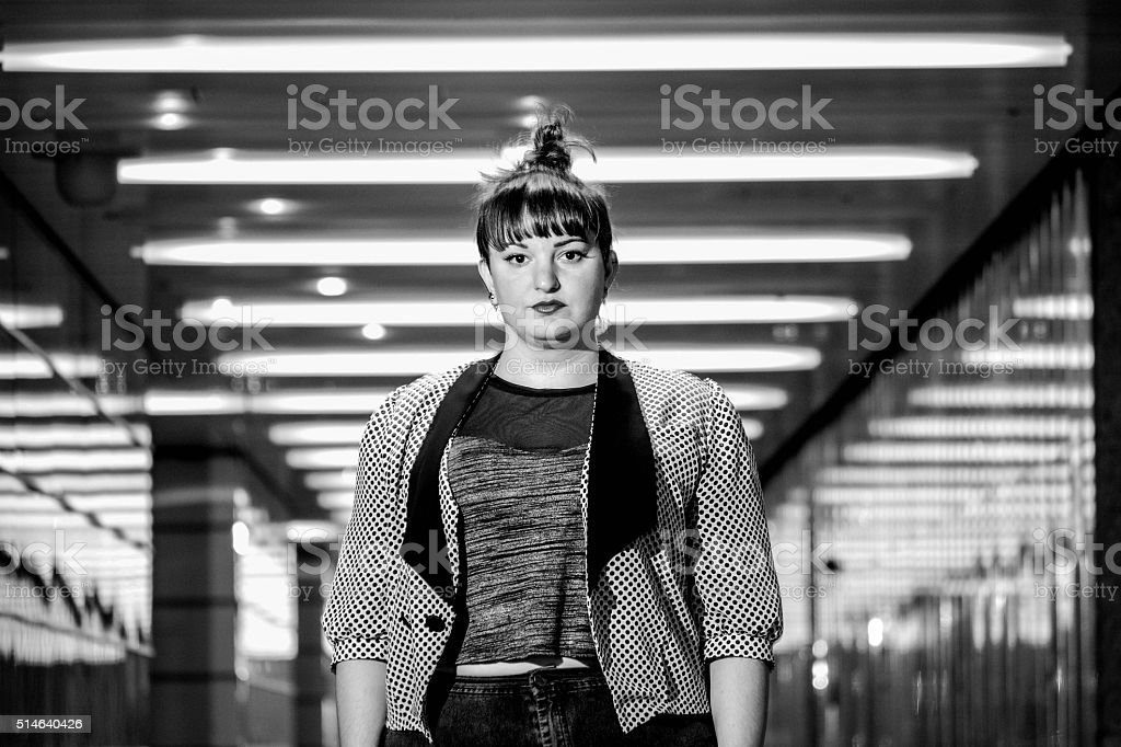 Young Attractive White Female Staring Into Camera, Monochrome stock photo