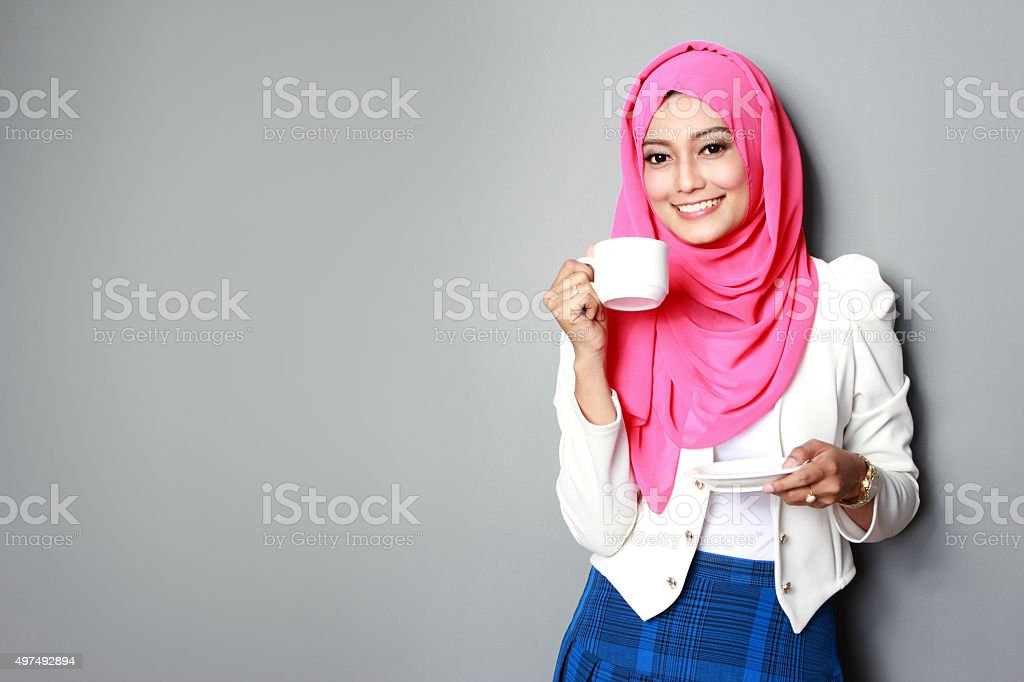 young attractive woman having a cup of tea stock photo