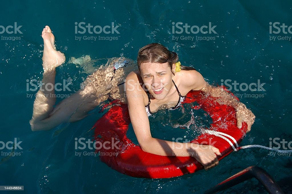 Young attractive woman help herself with the safety ring royalty-free stock photo