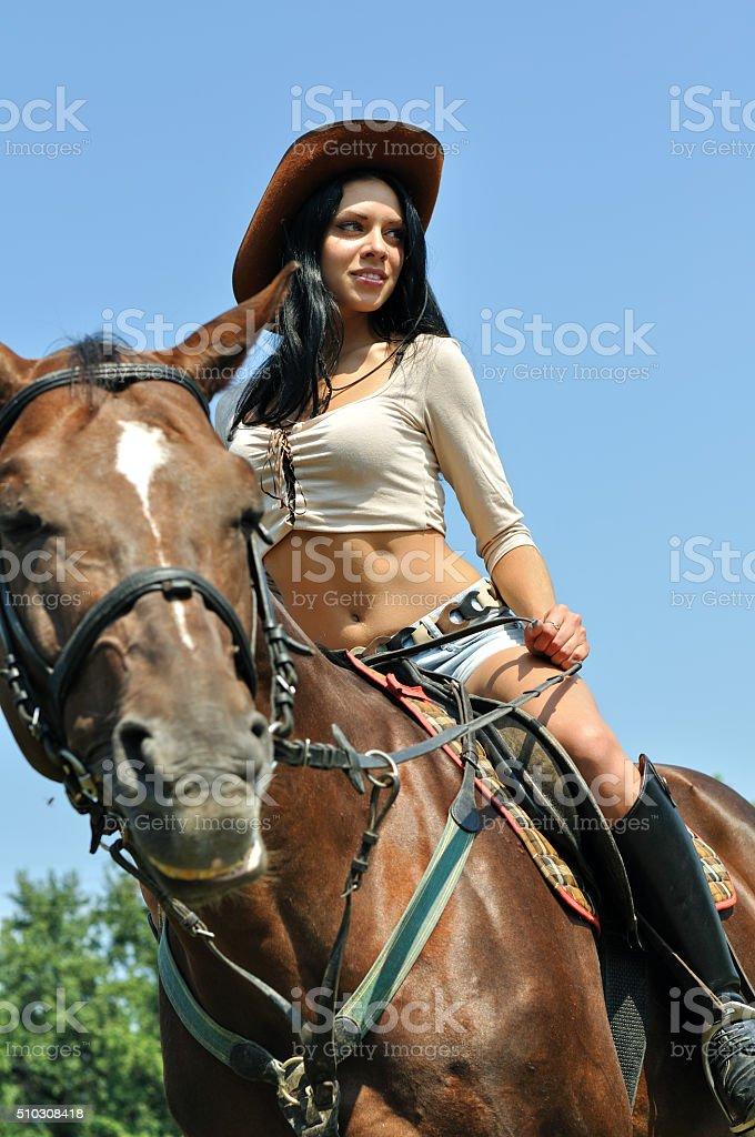 young attractive woman horseback riding stock photo