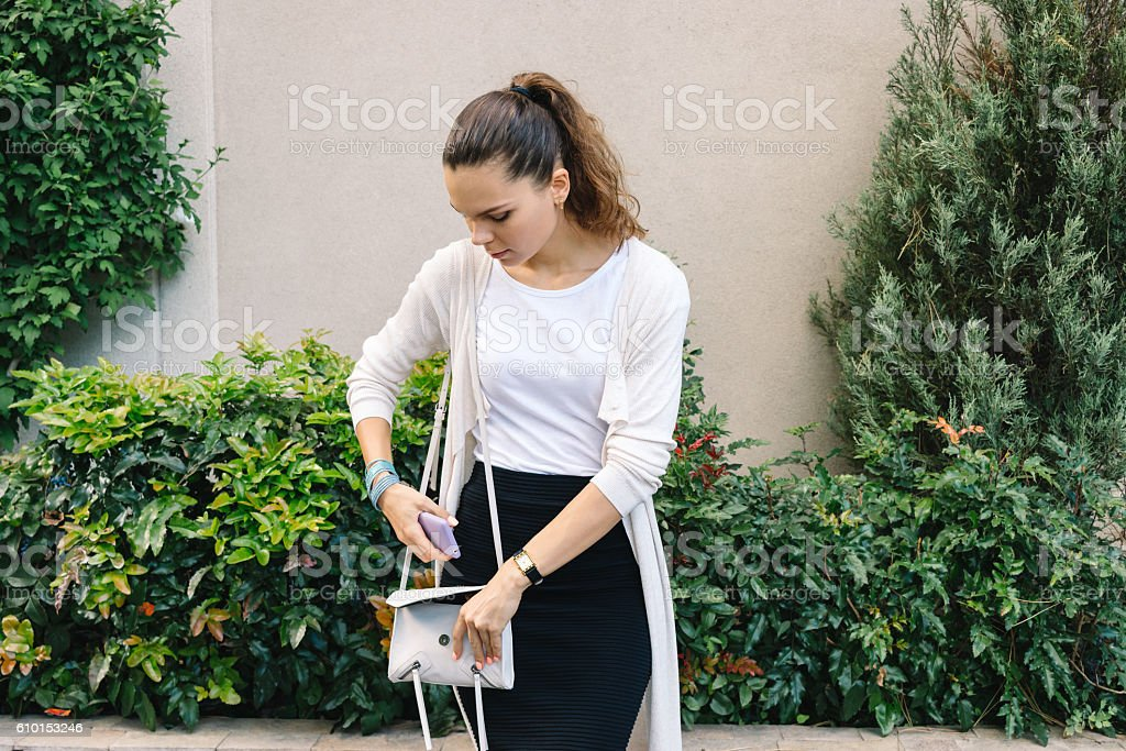 Young attractive woman in a cardigan and skirt stock photo
