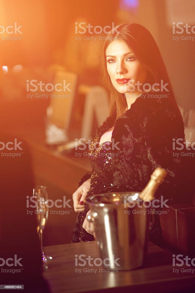 Young attractive woman in a night club stock photo