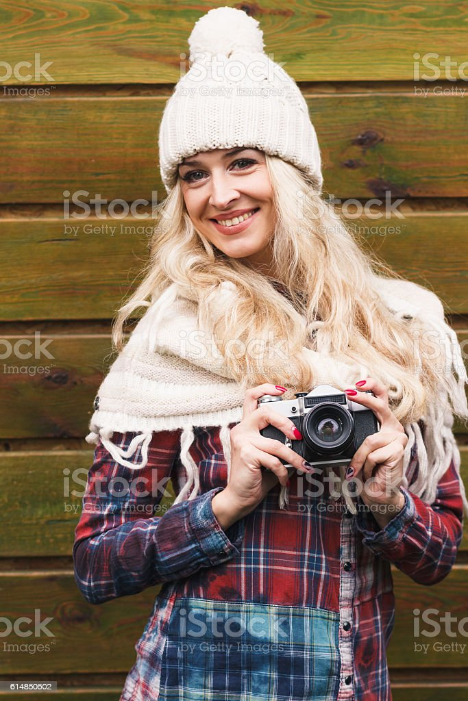 Young attractive woman in the cafe with camera stock photo