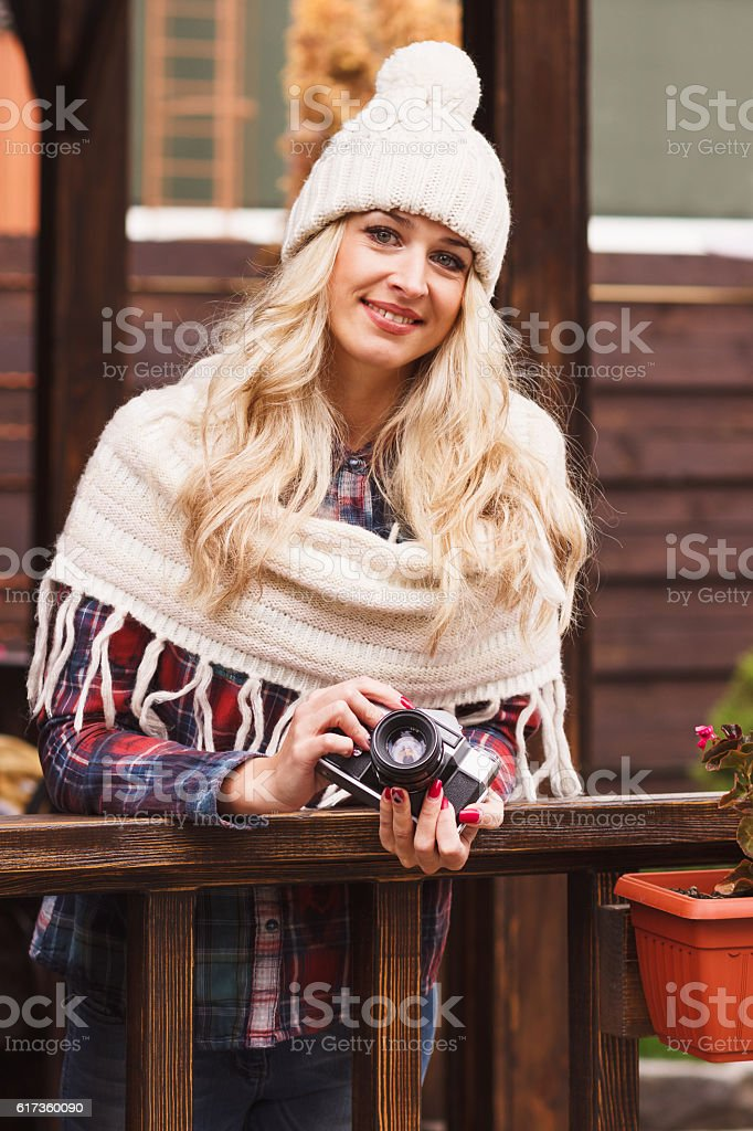 Young attractive woman in the cafe with old camera stock photo