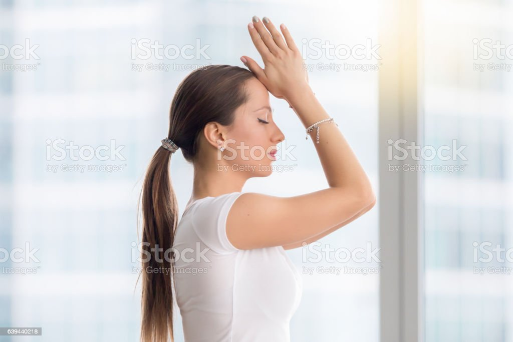 Young attractive woman in vajrasana pose, closeup stock photo