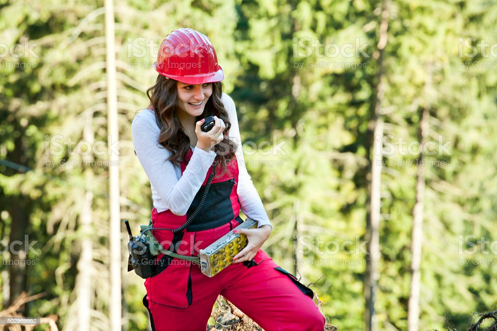 Young attractive woman manages forest works stock photo