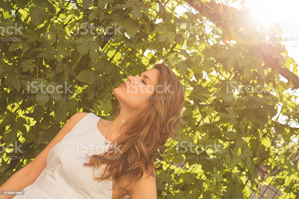 Young attractive woman posing outdoors. stock photo