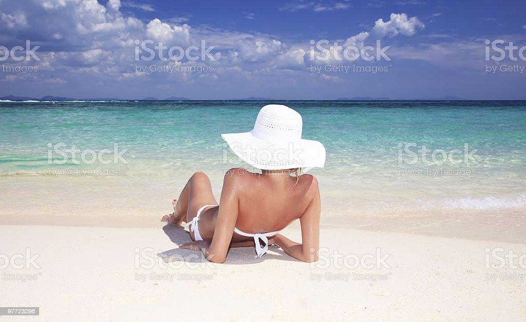 Young attractive woman relaxing on the beach. stock photo