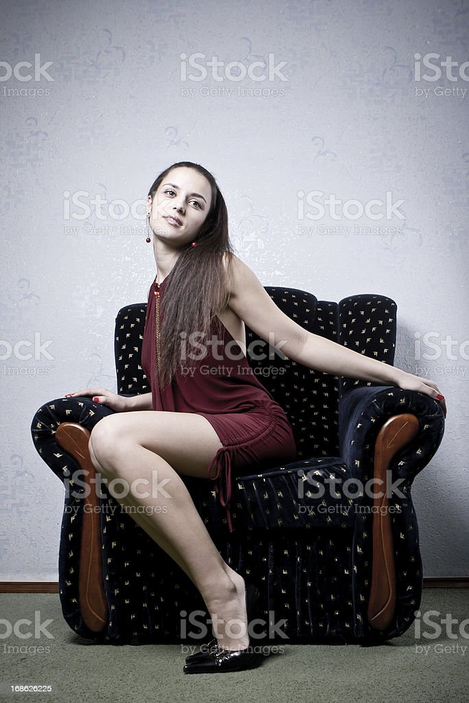 Young attractive woman sitting on armchair royalty-free stock photo