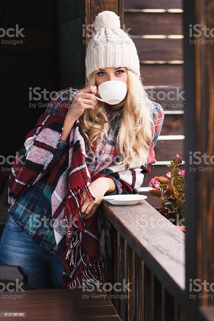 Young attractive woman with a cup of coffee stock photo