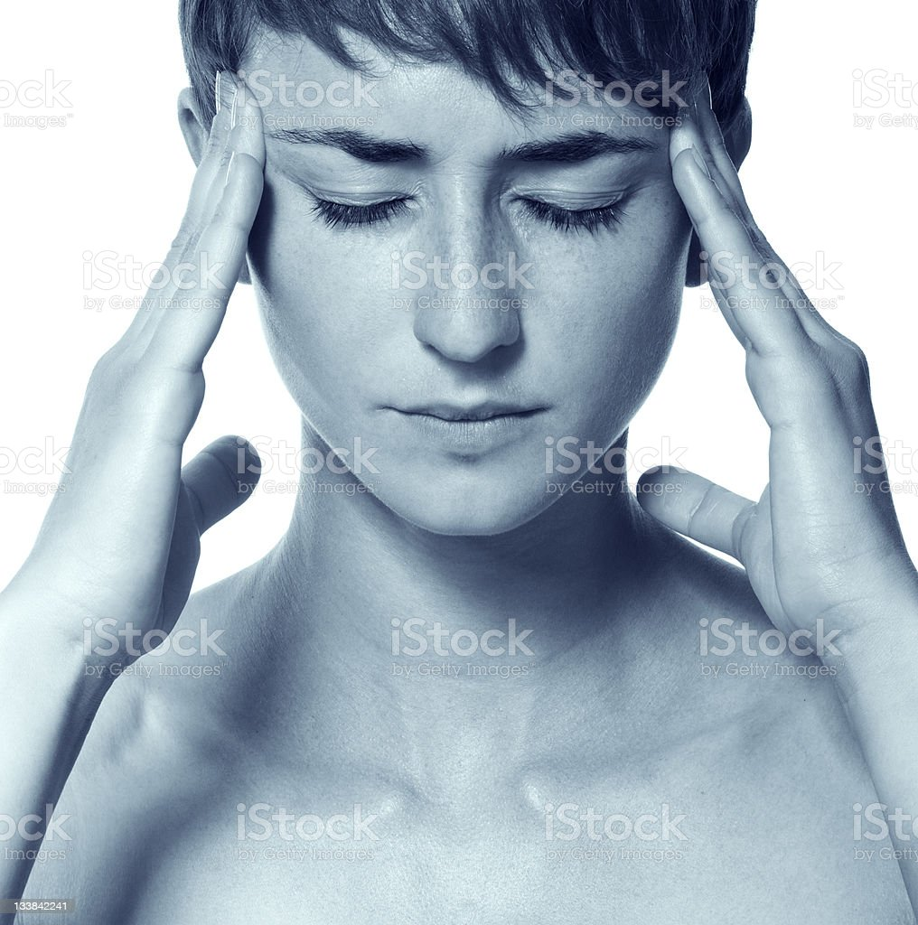 Young attractive woman with an awful migraine royalty-free stock photo