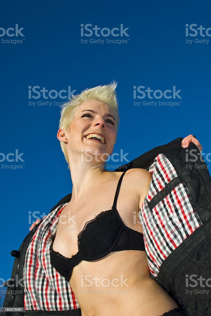 Young attractive woman with black bra opens her jacket royalty-free stock photo