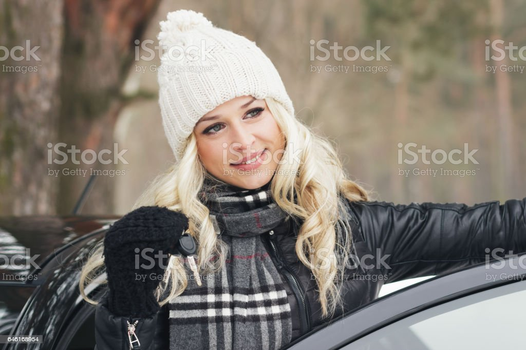 Young attractive woman with car keys in the hand stock photo