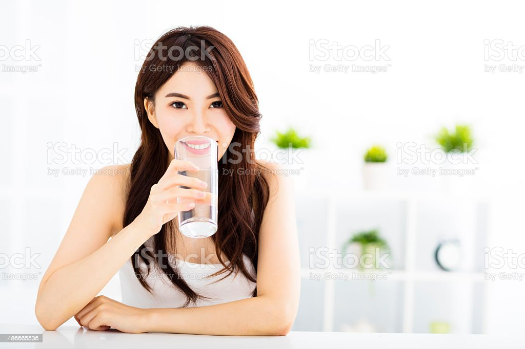 Young attractive woman with clean water stock photo