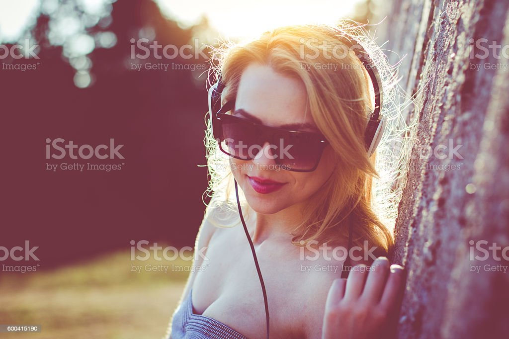 Young attractive woman with headphones stock photo
