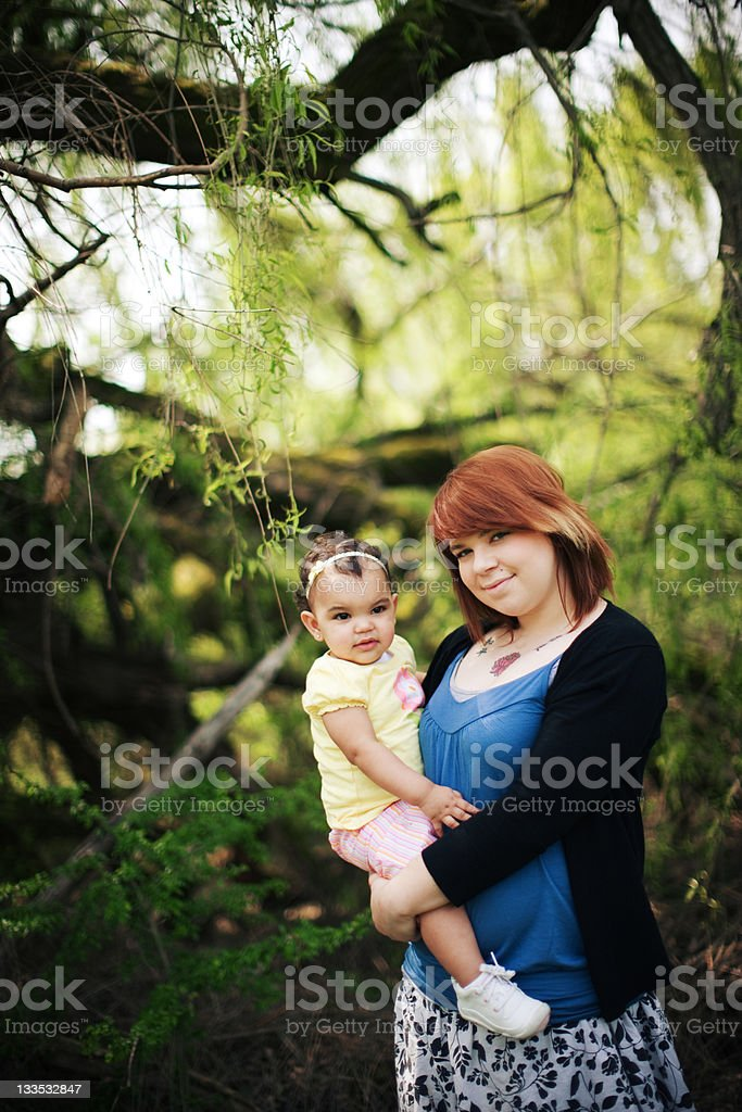 Young Aunt Holding her Little Niece royalty-free stock photo