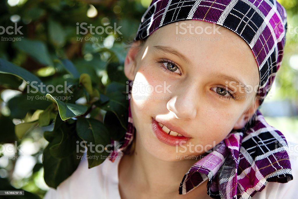 A young Australian girl wearing a plaid bandana stock photo