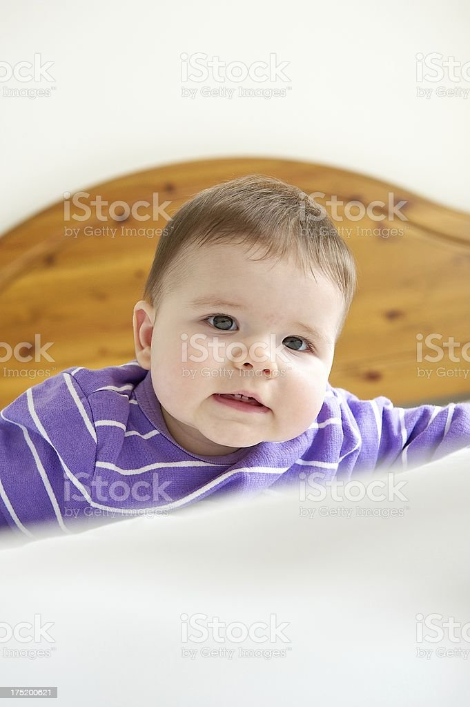 Young baby on bed royalty-free stock photo