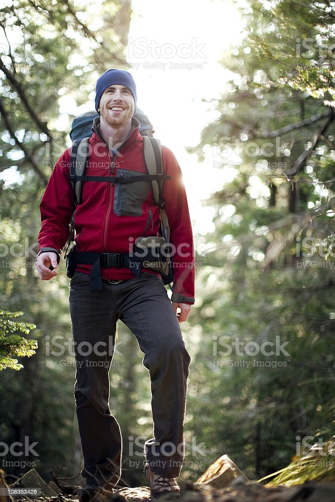 Young Backpacker Hiking in Woods royalty-free stock photo