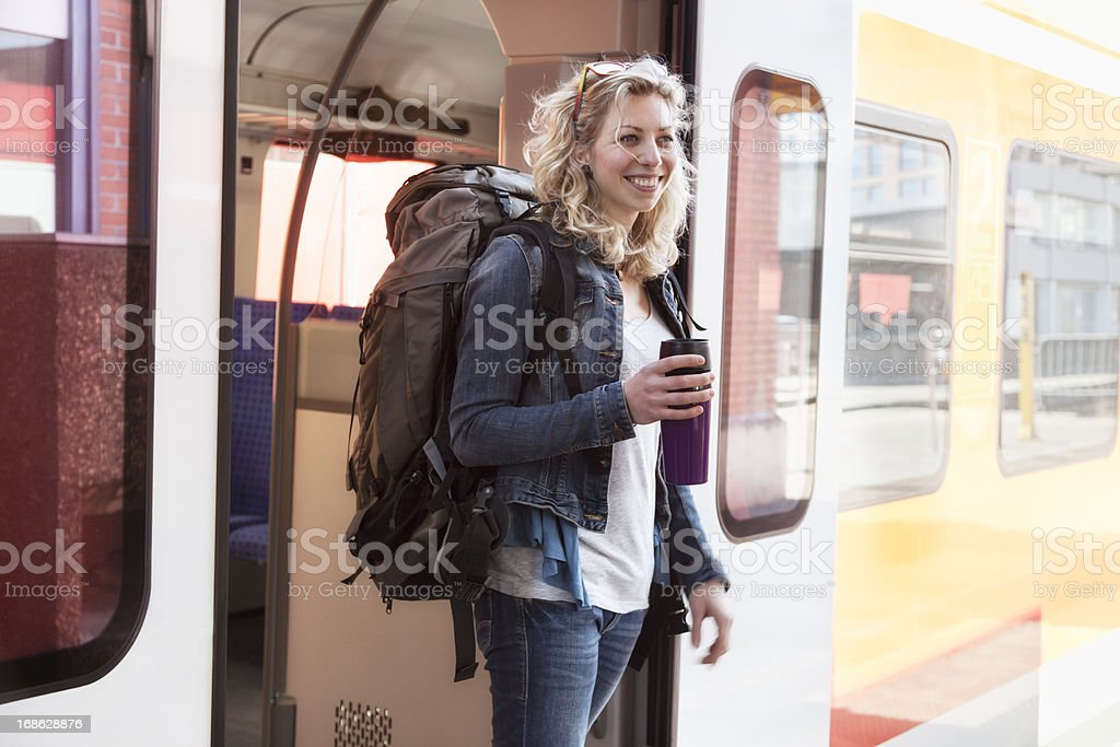 young backpacker woman arriving with train royalty-free stock photo