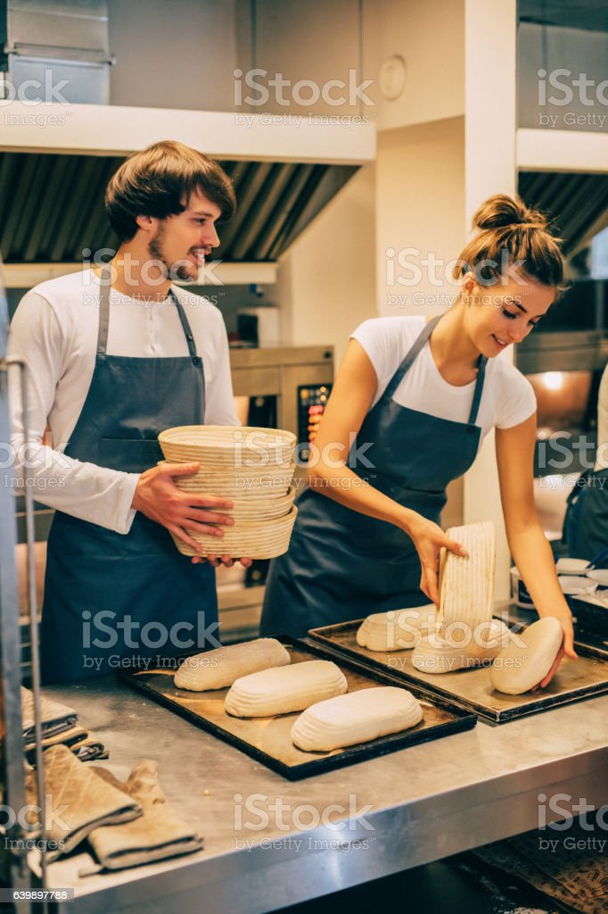 Young bakers making bread stock photo