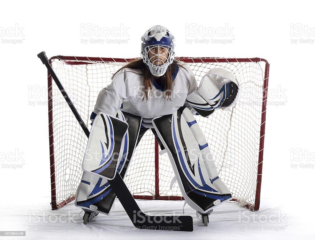 Young ball hockey goalie guards net. stock photo